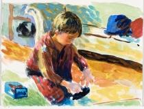 Gabriel jouant avec une auto